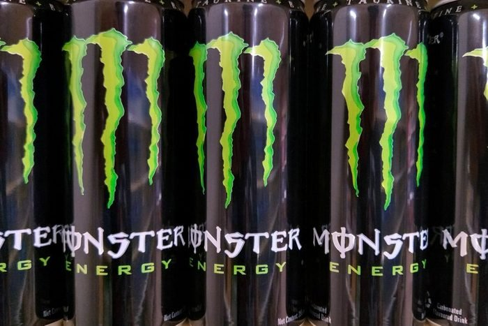 monster energy drinks on a store shelf at a gas station or grocery store