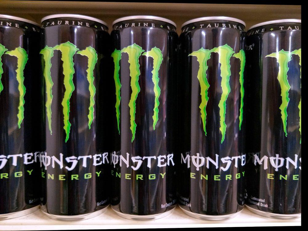 Kuala Lumpur, Malaysia- 26 February 2018:Monster energy drink cans on supermarket shelves.