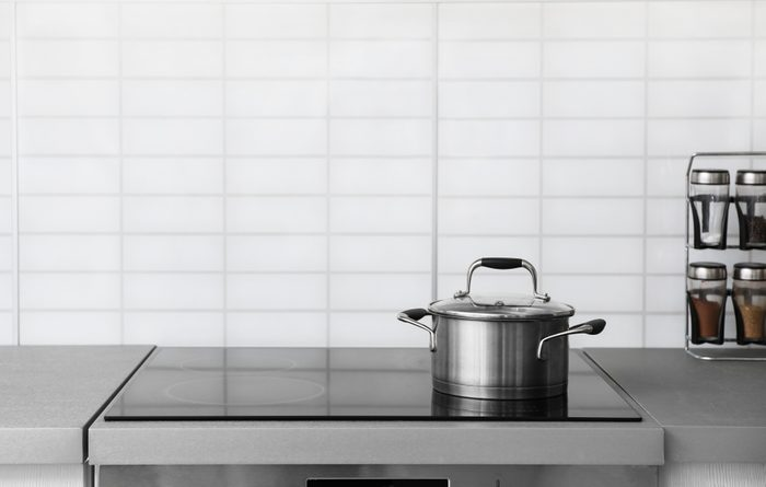 Casserole pot on electric stove in kitchen