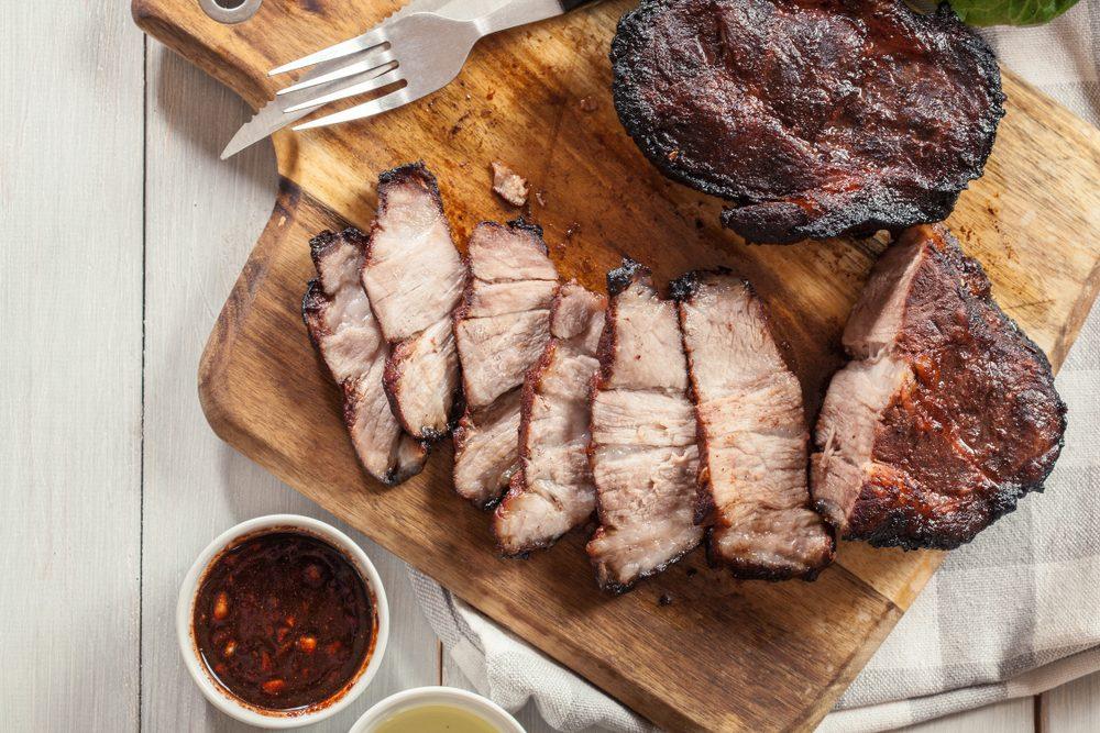 Char Siu Pork - Chinese roasted pork shoulder or pork belly on cutting board