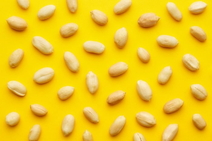 Peanuts pattern isolated on a yellow backround. Repetition concept. Top view