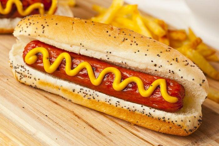 Organic All Beef Hotdog on a bun with mustard