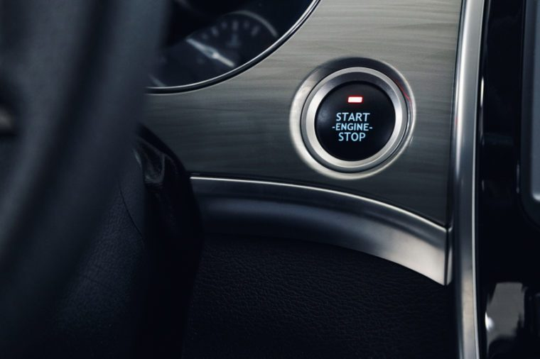 Car Start-Stop Engine Button of a modern car in the interior of the expensive car