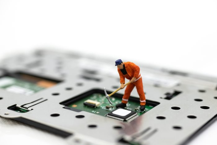 Miniature people: Worker repairing circuit board ,electronics repair. Use image for support and maintenance business.