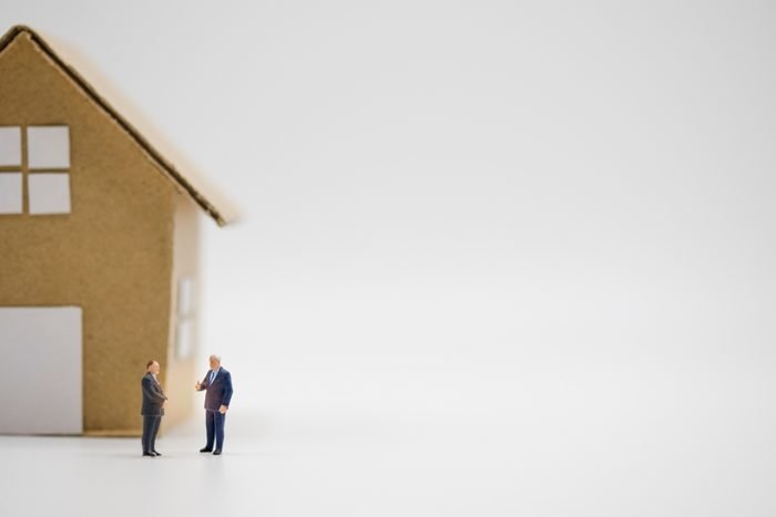 Two business men discuss of home and real estate for agreement investment. Real estate investor concept.-Image.