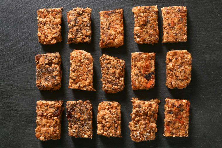 Tasty granola bars on dark background