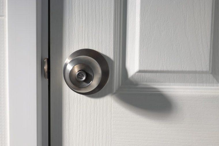 A doorknob on a wooden door