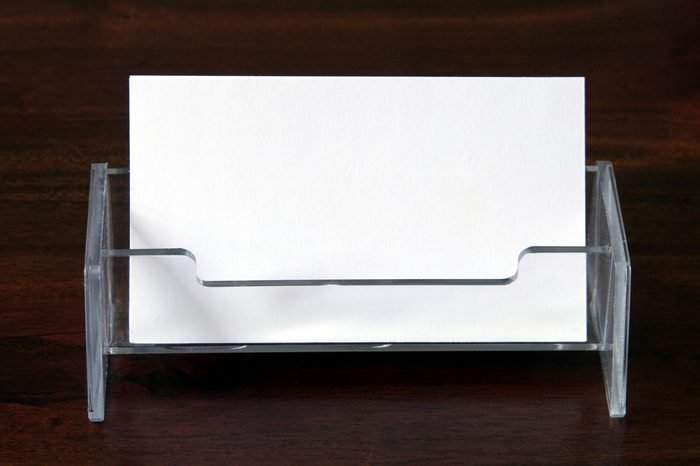 Blank Business Cards In Transparent Card Holder On Dark Wood Table