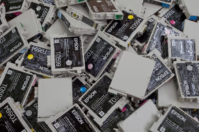 FALLS CHURCH, VA - JULY 18: A load of used non refillable OEM brand name ink cartridges going for plastic recycling lying on a heap on July 18, 2014 in Falls Church, VA.