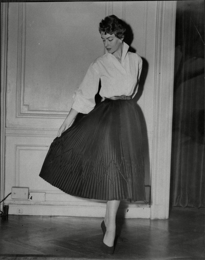 Fashion Women 1953 Model Wearing Various Street Fashions.