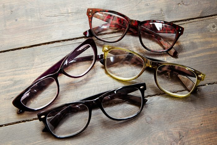 reading glasses on wooden background