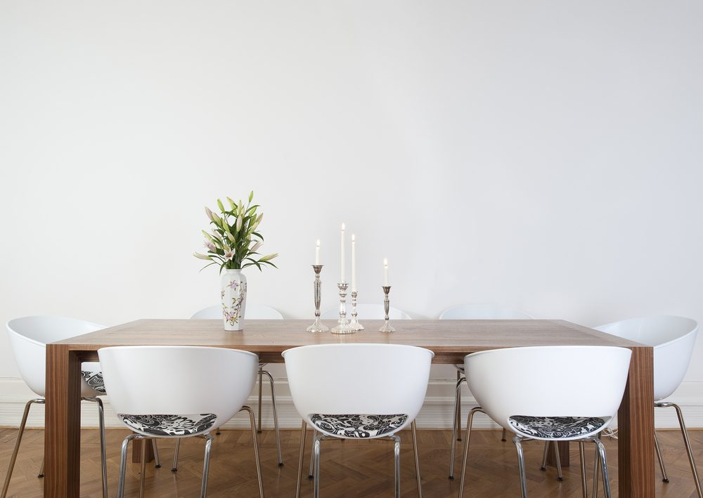 Modern dining room with big white wall