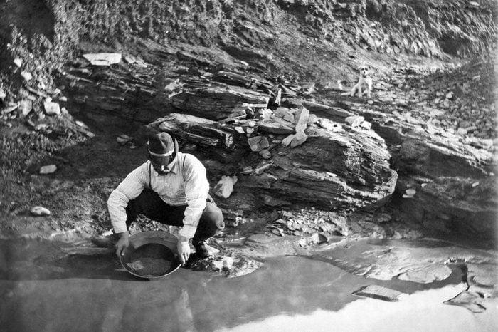 VARIOUS Dexter, Alaska: June 20, 1902. A gold miner panning for gold in Alaska.