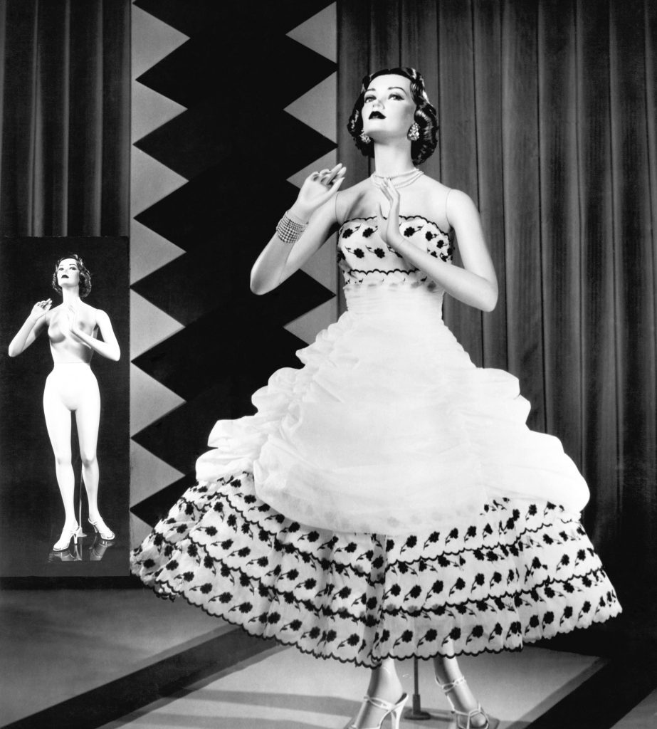 VARIOUS c. 1950 A fashionable mannequin and her unclothed version in the background.