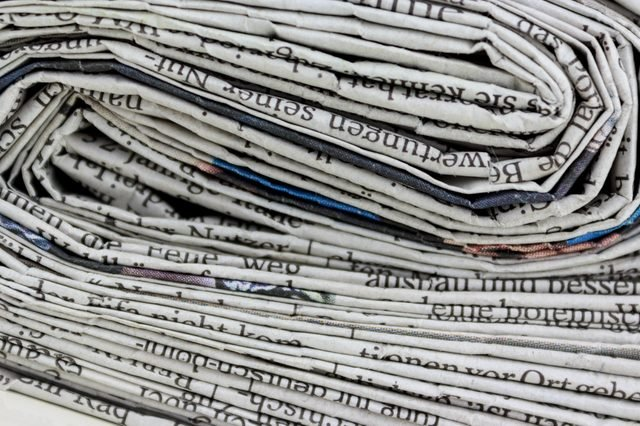 stacked old newspapers pile of newspapers