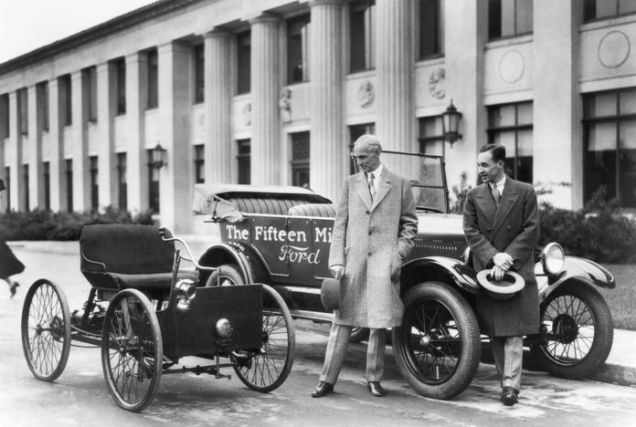 VARIOUS Detroit, Michigan: 1927 Henry Ford (left) and Edsel Ford with the original 1896 Quadricycle and the 15th millionth Ford Model T.