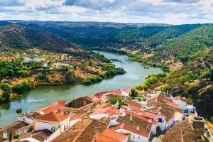 The river Guadiana and the village of Mertola. Alentejo Region. Portugal