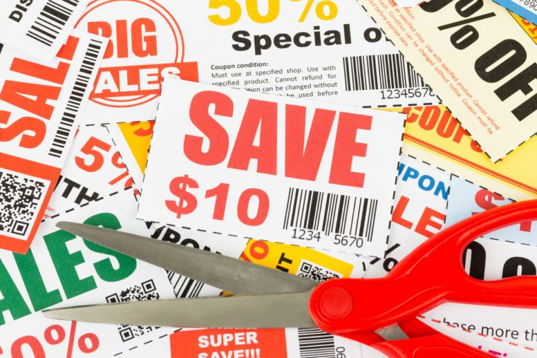 Saving discount coupon voucher with scissors, coupons are mock-up
