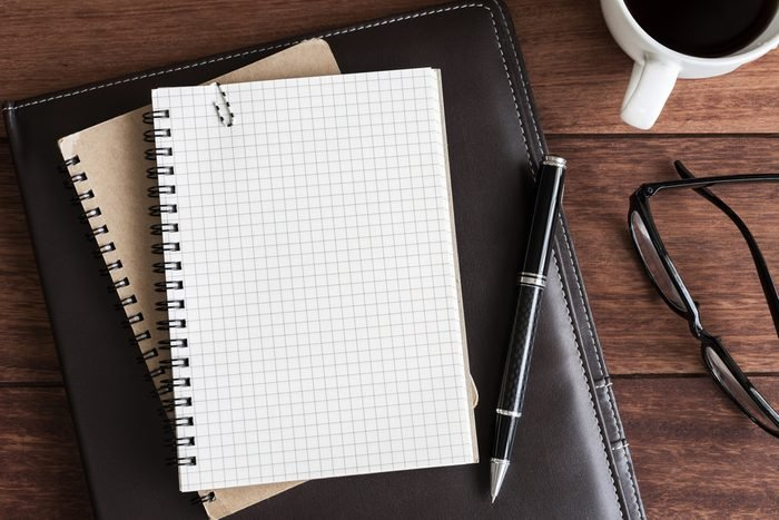 notebook with cup of coffee on office desk, Top view