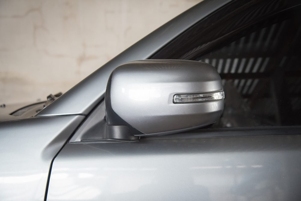 Car mirrors folded in with car fob