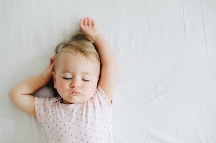 One year old baby girl sleeping.
