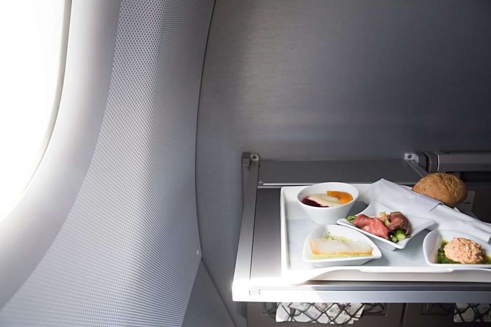 photo of Food served on board of business class airplane on the table
