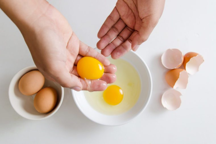 Egg yolk separate on the hand for cooking,food ingredient