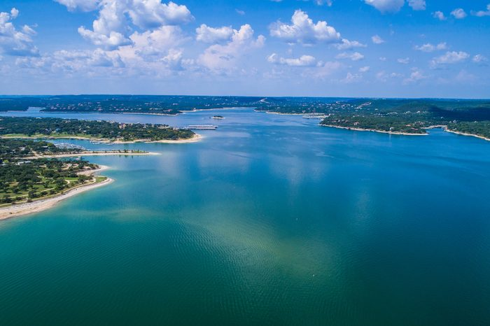 Reflections on the water Lake Travis a paradise of clear blue water and relaxation right outside Austin Texas an amazing summer landscape on the lake aerial drone view high above lake