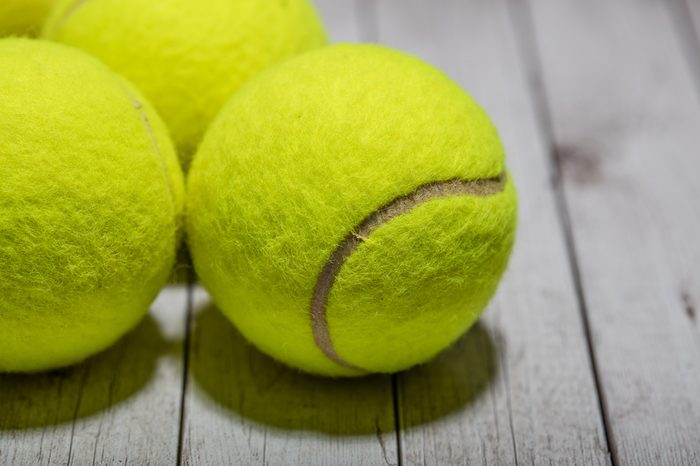 tennis balls on wooden table