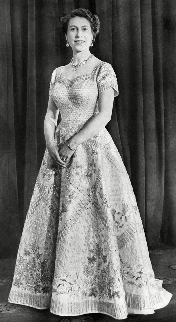 Historical Collection 84 A Photograph Taken at the Special Request of the Queen in Order to Showcase the Workmanship of the Gown the Work of Norman Hartnell It is White Satin with A Fitted Bodice and Neck-line Cut Square Over the Shoulders Before Curving Into A Heart Shape the Gown Features Golden Crystals Graduated Diamonds and Pearls As Well As Representations of the Leek of Wales Thistle of Scotland Shamrock of Ireland and Tudor Rose of England 1953