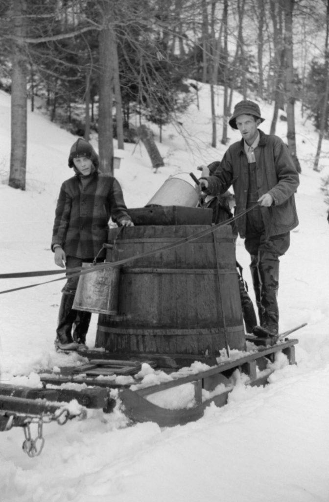 VARIOUS Father and Son on Sled with Vat full of Sap from Sugar Maple Trees, Waitsfield, Vermont, USA, Marion Post Wolcott for Farm Security Administration, April 1940
