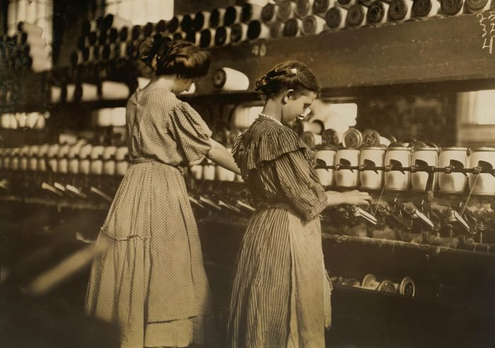 VARIOUS Two Young Girls at Spoolers, Lincoln Cotton Mills, Evansville, Indiana, USA, Lewis Hine for National Child Labor Committee, October 1908