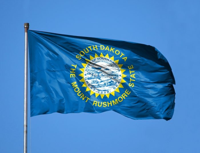 National flag State of South Dakota on a flagpole