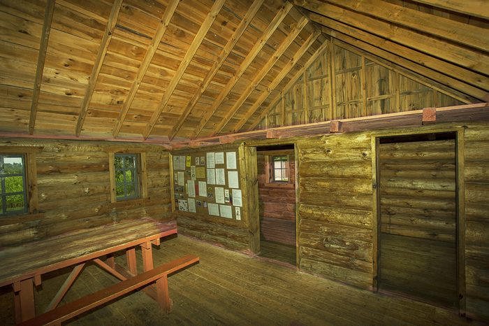 """Stockholm, WI USA August 28, 2016: """"Little House on the Prairie"""" author, Laura Ingalls Wilder's, reconstructed three room, log cabin birthplace home interior in Stockholm Wisconsin."""
