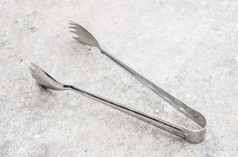 tongs isolated background.