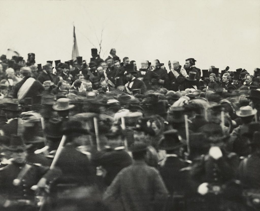 VARIOUS U.S. President Abraham Lincoln (without Hat below Flag slightly right) Standing Amongst Crowd during Dedication of Soldier's National Cemetery where he Delivered his Famous Speech, the Gettysburg Address, Gettysburg, Pennsylvania, USA, November 19, 1863