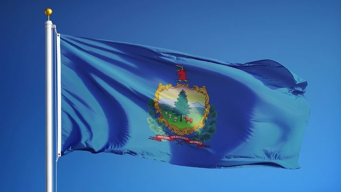 Vermont (U.S. state) flag waving against clear blue sky, close up, isolated with clipping path mask alpha channel transparency, perfect for film, news, composition