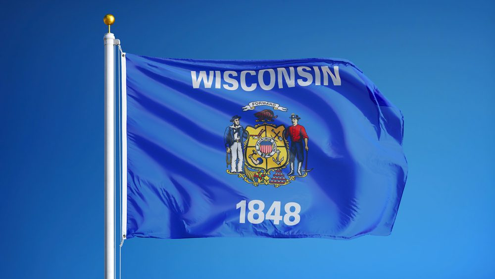 Wisconsin (U.S. state) flag waving against clear blue sky, close up, isolated with clipping path mask alpha channel transparency, perfect for film, news, composition