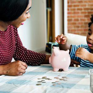 mother cild son piggy bank save money