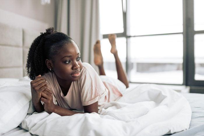 sad depressed woman bed