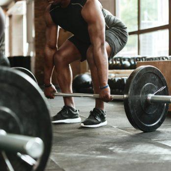 man lift weights gym