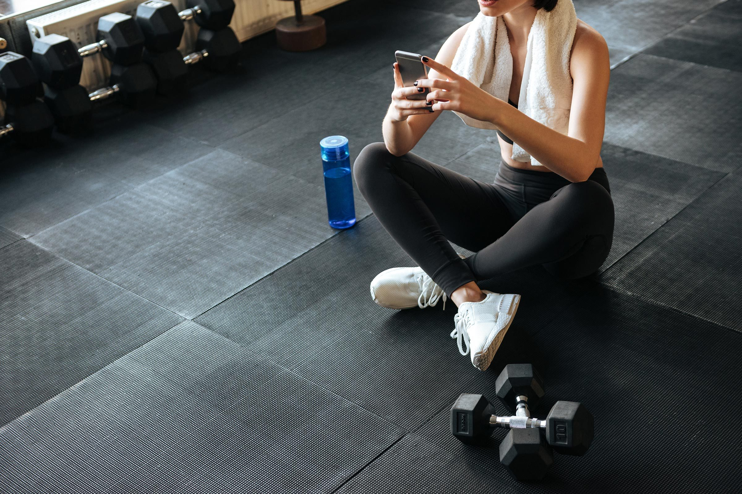 woman phone gym