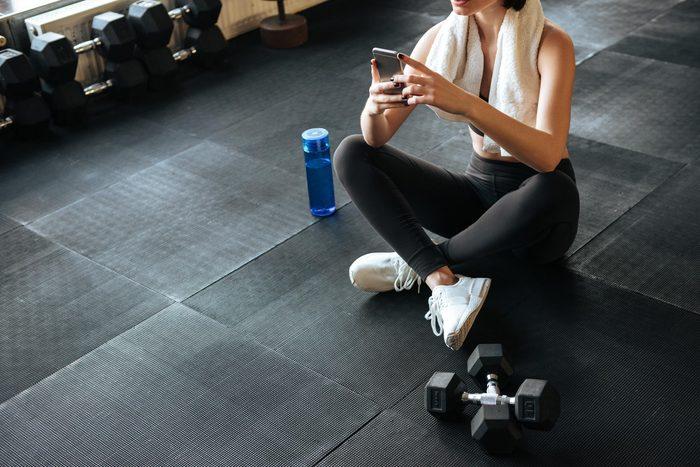 woman phone gym