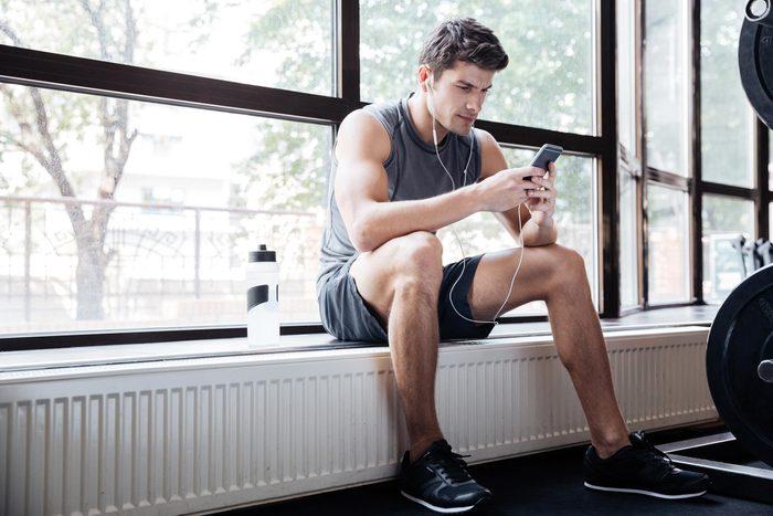 man phone gym