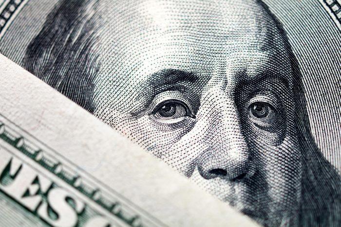 cloes up hundred dollar bill