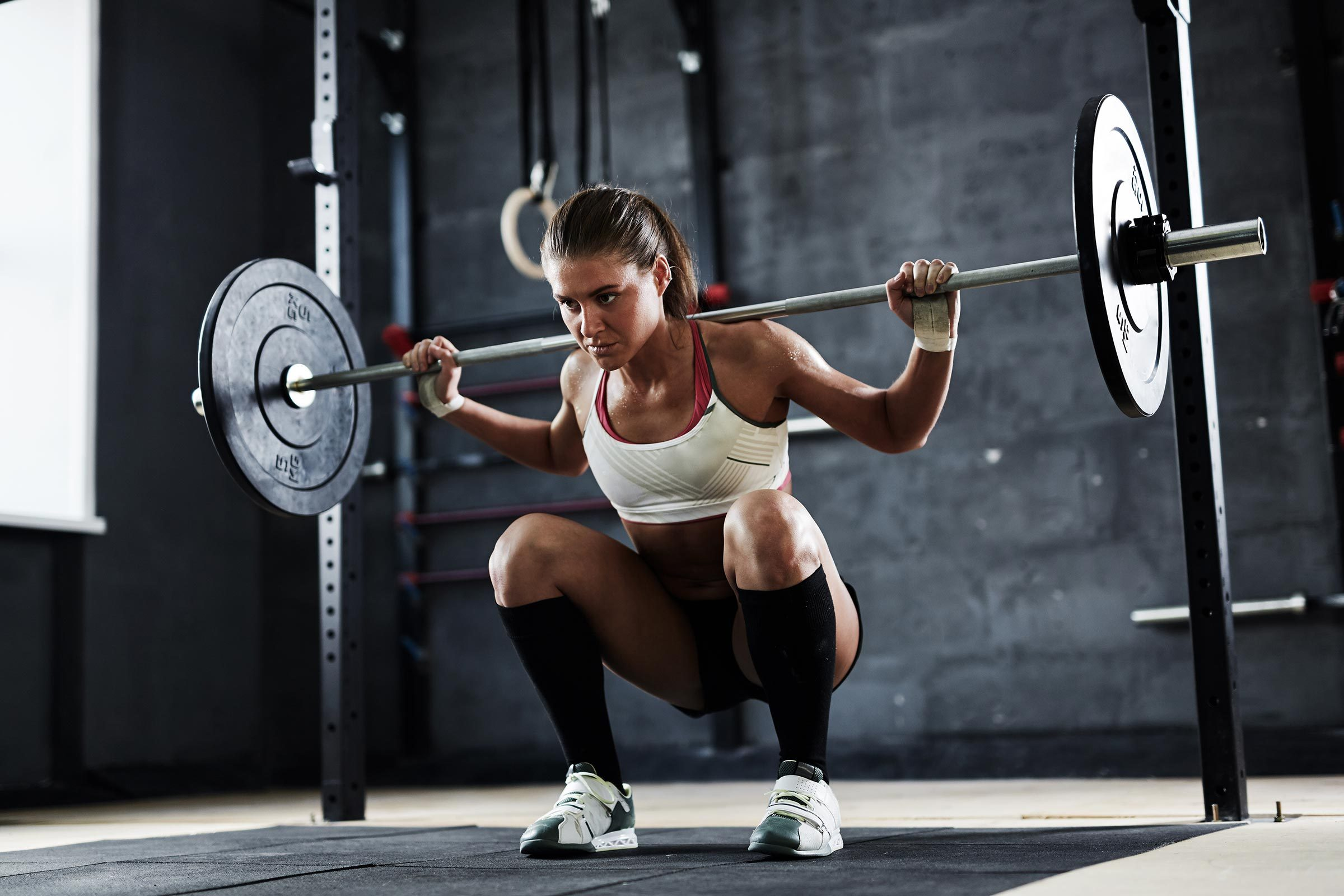 woman squat rack gym