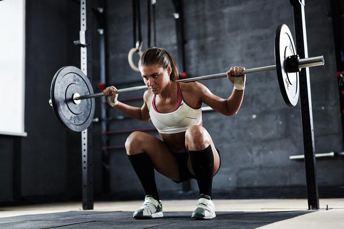 woman squat rack gym