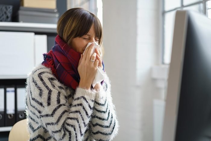 woman blow nose sneeze