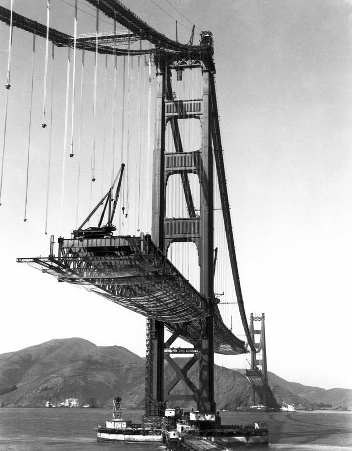 VARIOUS San Francisco, California: October 16, 1936. The Golden Gate Bridge under construction, with the roadbed being suspended from the cables.