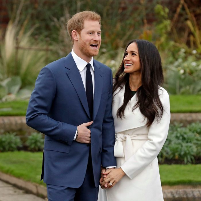 Britain's Prince Harry and his fiancee Meghan Markle pose for photographers during a photocall in the grounds of Kensington Palace in London